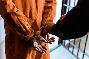 Inmate in handcuffs for safety and officer